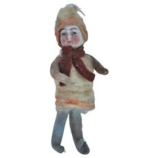 An antique Christmas bisque headed cotton batting girl decoration,