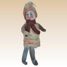 An antique Christmas bisque headed cotton batting girl decoration,