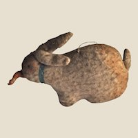 Early brushed cotton primitive rabbit with carrot, circa 1910