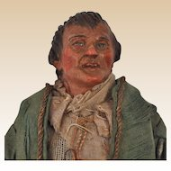 An early 19th century Neapolitan creche figure of an ugly man,