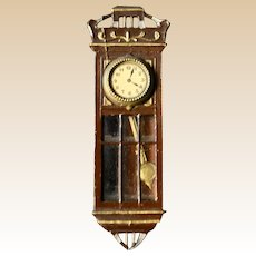 A lovely German soft metal and tinplate wall clock, 1910s
