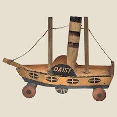 Very rare mid 19th century wooden and cardboard Daisy paddle steamer,