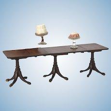 Rare and fine mahogany three-pedestal dining table,