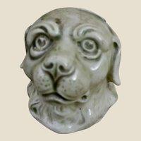 A continental pottery dog head money bank, circa 1900