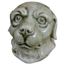 A continental pottery dog head money bank, circa 1900