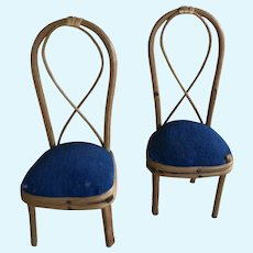 Two antique dolls' house bent-wood chairs,