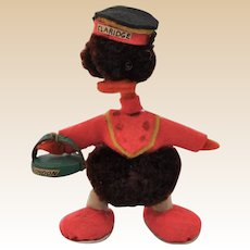 A lovely miniature woolen pom-pom duckling dressed as a Claridge bellhop, 1950s