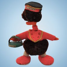 A lovely miniature woolen pom-pom duckling dressed as a Claridge bellhop, 1950s
