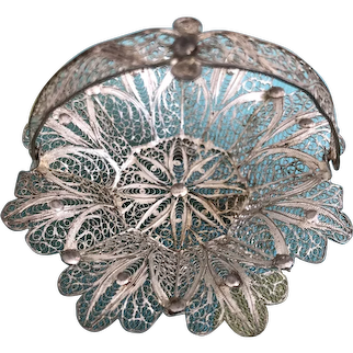 A beautiful detailed Continental silver doll's or dolls' house miniature fruit basket with hinged handle,