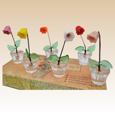 A lovely set of vintage glass flower pots place settings, ideal for your dolls' house