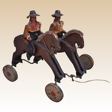 Rare vintage Folk Art wooden cowboy pull-a-long toy 1920s,