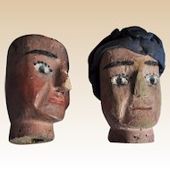 A pair of Folk Art carved wooden puppet heads, circa 1900