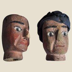 A pair of Folk Art carved wooden puppet heads, circa 1900