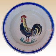 A faience cockerel bowl, late 19th/early 20th century