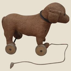 A charming French cotton dachshund on wheels 1910-20s,