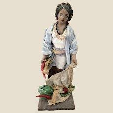 A cloth pedlar vegetable seller doll, probably South American