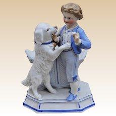 A German porcelain vase with a boy and dog, 19th century