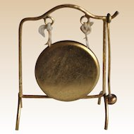 A German gilt metal dolls' house floor standing dinner gong, circa 1910,