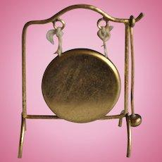 A German gilt metal dolls' house floor standing dinner gong, circa 1910,