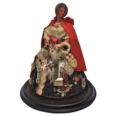 A stunning and rare mid 19th century pedlar doll, possibly by Henrietta Wade