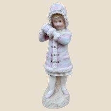 A beautiful Gebruder Heubach bisque figure of a girl in winter,