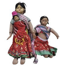 Two vintage Indian hand stitched cloth dolls in saris,