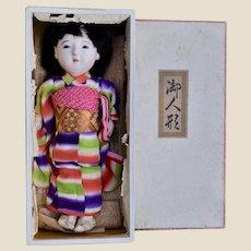 A boxed Ichimatsu Gofun composition Japanese girl doll 1930s