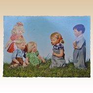 A wonderful Kathe Kruse postcard of a sack race, German Child