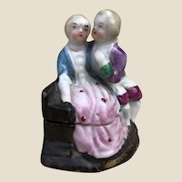 A small early 20th century German courting couple trinket pot,