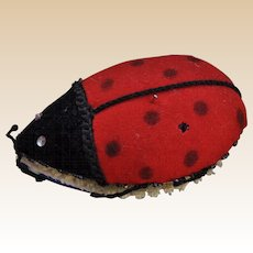 A charming vintage hand crafted felt ladybird pin cushion needle case