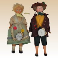 A pair of Lenci hard plastic dolls with felt costumes and card labels,