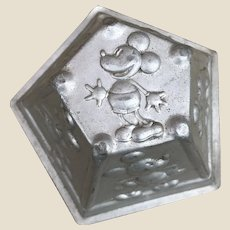 A rare Disney aluminium jelly mould featuring Mickey, Minnie, Pluto, Clarabelle and Horace 1930s,