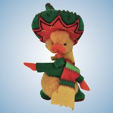 A lovely miniature woolen pom-pom duckling dressed as a Mexican, 1950s