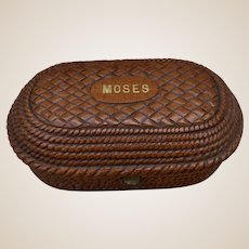 A very unusual Victorian treen purse in the form of a Moses basket,