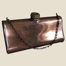 A rare antique copper muff warmer,