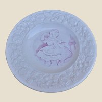 A mid 19th century pearlware nursery plate with girl and kitten,