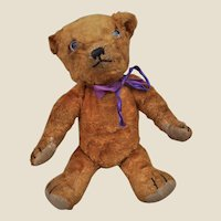 A rare Omega orange artificial silk plush teddy bear 1930s,