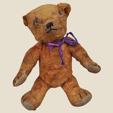 A rare Omega orange artificial silk plush teddy bear 1930s,