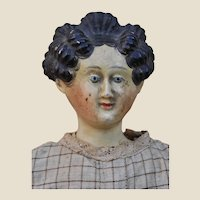 A wonderful early papier-mâché doll with Apollo knot hair style,