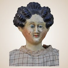A wonderful early papier-mâché doll with Apollo knot hair style,