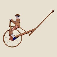 A wonderful British folk art penny farthing toy, 1920s