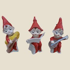 Three rare German bisque Christmas googly eyed pixies with moving heads,