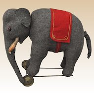 Rare Schuco yes/no felt elephant on wheels, 1920s