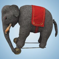 Rare Schuco yes/no felt elephant on wheels, 1920s