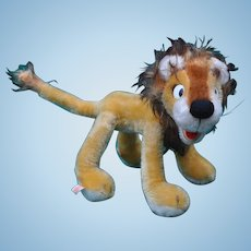 A charming comic Schuco bigo-bello lion with label