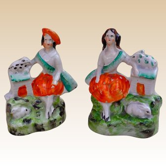 An appealing pair of Staffordshire figures of Scottish children with rabbits, circa 1850