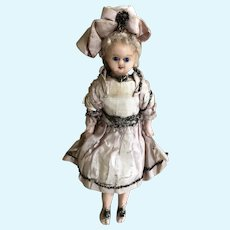A lovely all original German wax over composition small child doll circa 1890,