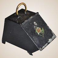An antique dolls' house tinplate coal scuttle,