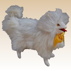 A white fur Spitz or Pomeranian dog ideal a companion for your doll,