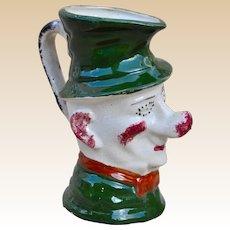 A rare British spongeware Ally Super character jug, circa 1900